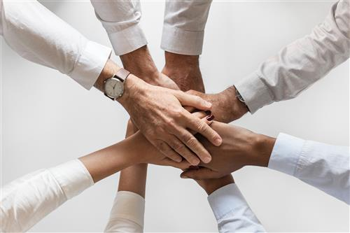 Photo of Hands Symbolizing working together
