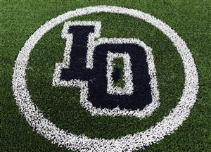 The letters L and O painted on the new artificial turf field