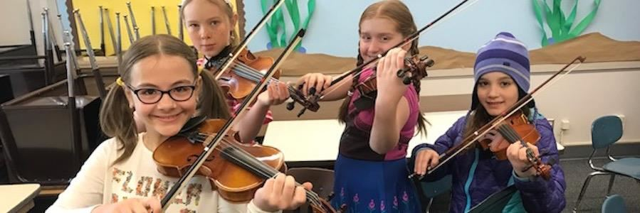 Photo of children with violas